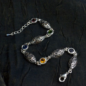 Medieval colored jewel and carved silver bracelet